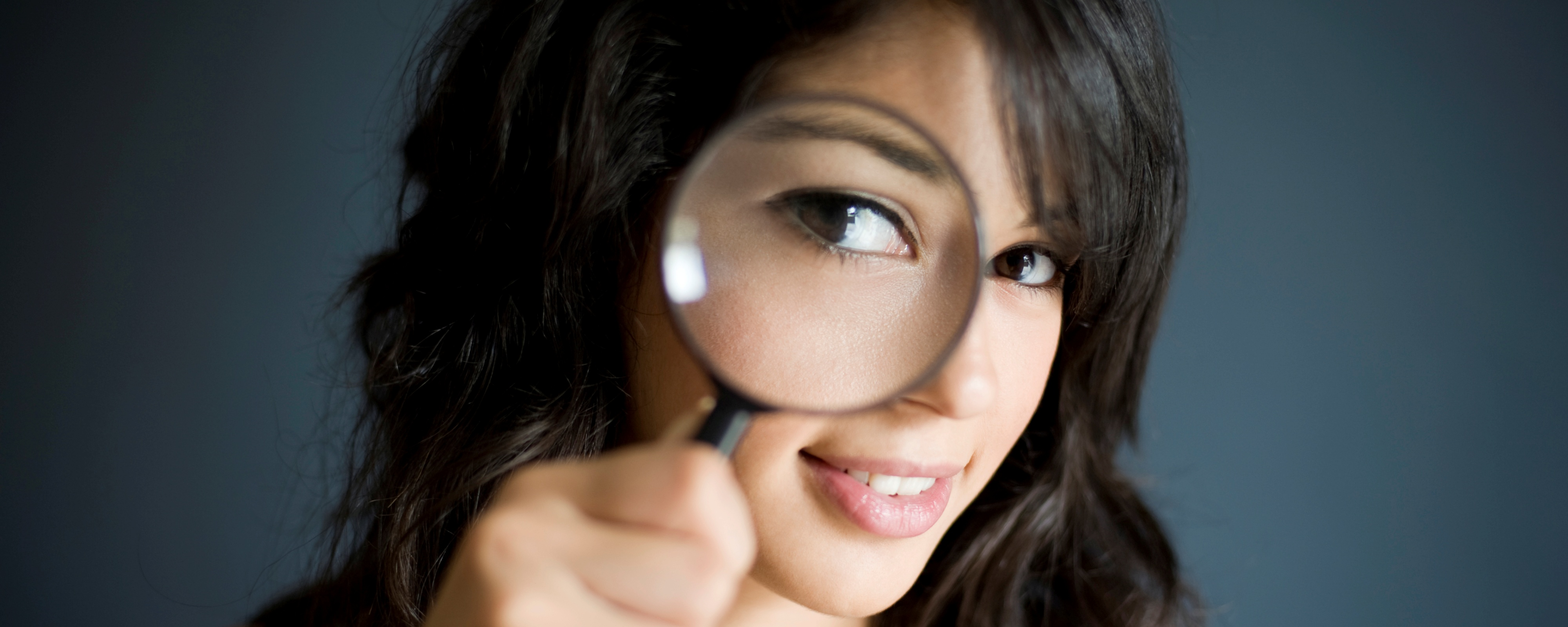 4000x1600 woman+with+magnifier_istock_000007178243xlarge